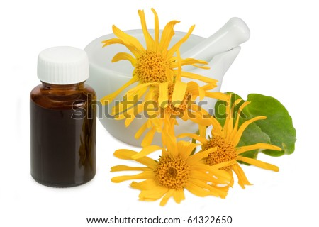 Arnica blossoms and mortar with little brown bottle over white - stock photo