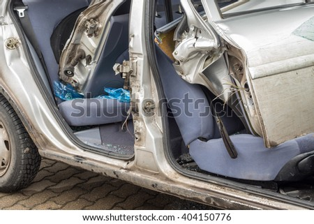 ARNSDORF, GERMANY - MARCH 31, 2016: detail of a car accident and wrecked car - stock photo