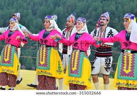 AROLLA, SWITZERLAND - AUGUST 12: Turkish dancers from Bozdaglar in the CIME mountain culture Festival: August 12, 2015 in Arolla, Switzerland - stock photo