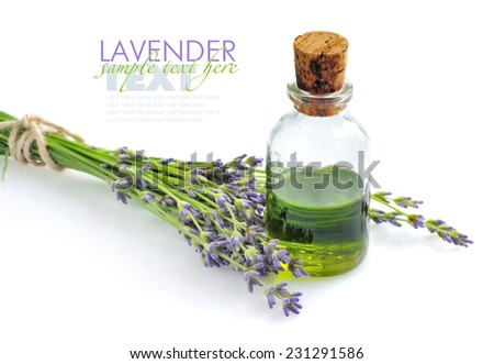 Aroma oil and lavender flowers - stock photo