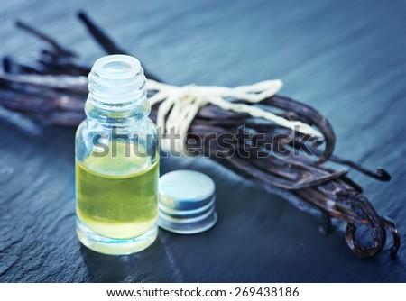 aroma oil in glass bottle, vanilla oil - stock photo