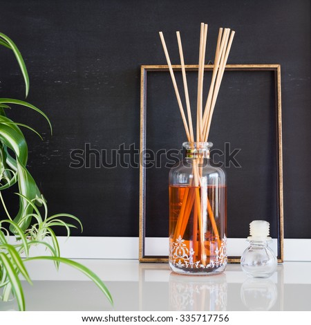 Aroma reed diffuser in contemporary style home interior - stock photo