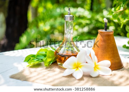 aroma set and flower in garden - stock photo