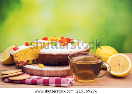 aroma tea and pie on table background - stock photo