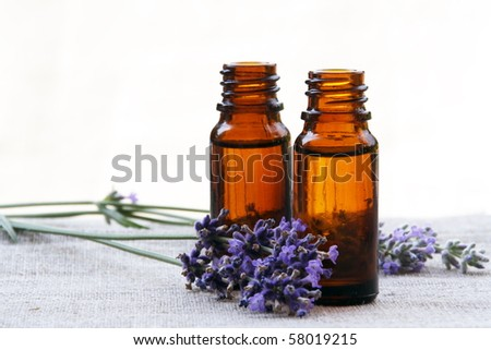 Aromatherapy Aroma Scented Oil in Glass Bottles with Lavender - stock photo