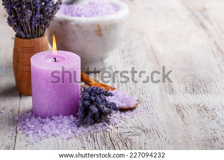 Aromatherapy concept, candle with lavender flowers - stock photo