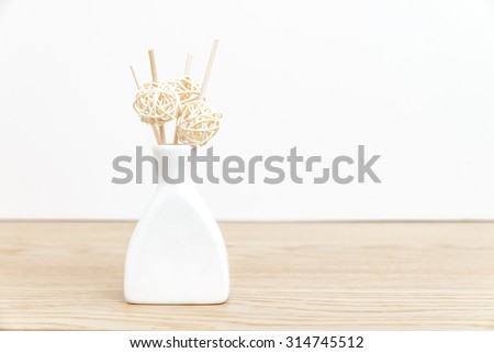 Aromatherapy diffuser on wood table against white background with copy space for text. - stock photo