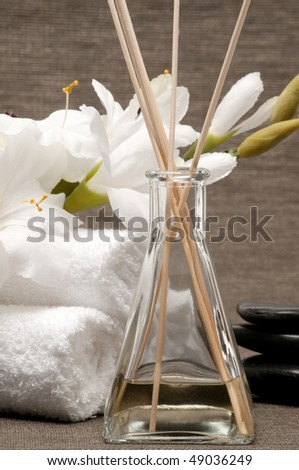 Aromatherapy diffuser, towels, stones and flower - stock photo