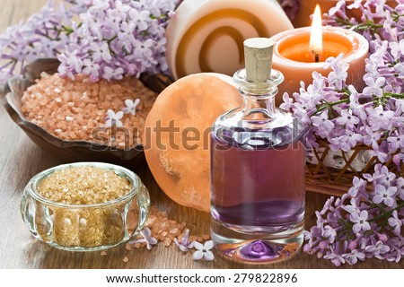Aromatherapy essential oil, brown sugar, sea salt, natural soap and lilac flower  - stock photo