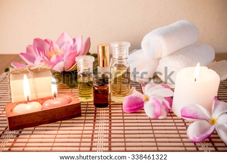 Aromatherapy essential oil, natural soap and lilac flower - stock photo
