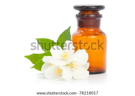 Aromatherapy. Jasmine with bottle isolated on white background - stock photo
