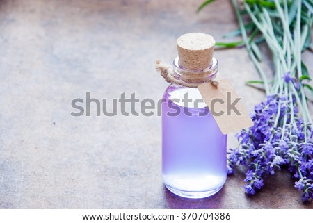 Aromatherapy oil and lavender, lavender spa, Wellness with lavender, lavender syrup on a wooden background - stock photo