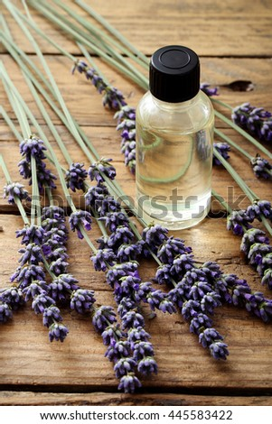 Aromatherapy oil and lavender, lavender spa, Wellness with lavender, on a wooden background  - stock photo