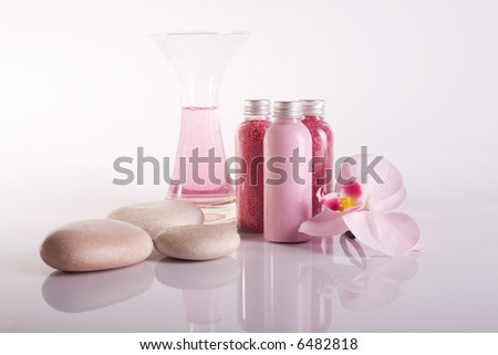 aromatherapy setup with orchid flower - stock photo