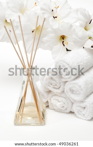 Aromatherapy Spa diffuser with towels and flower in spa - stock photo