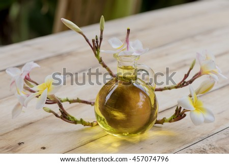 Aromatherapy Spa Massage Oil: Plumeria Scents or leelawadee thai name Scents or oil massage. (Aroma helps to relax). - stock photo