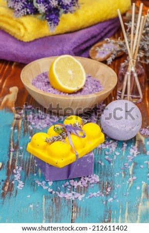 Aromatherapy with lemon and herbs. Spa salt, lavender, foaming bath bomb and  soap.  Spa and body care concept. Macro, selective focus - stock photo