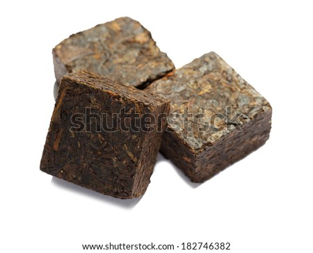 Aromatic black pu-erh tea from yunnan province in China. Leaves undergoes double fermentation and compressed into bricks. Healthy hot drink, natural anti-biotic medicine - stock photo
