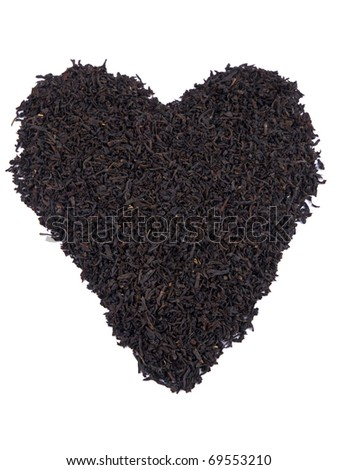 Aromatic black tea leaves formed on heart on white background