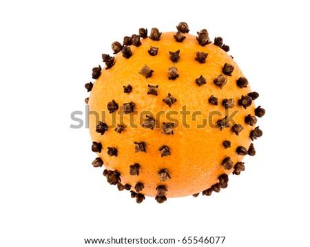 Aromatic Christmas orange with cloves isolated on white background - stock photo