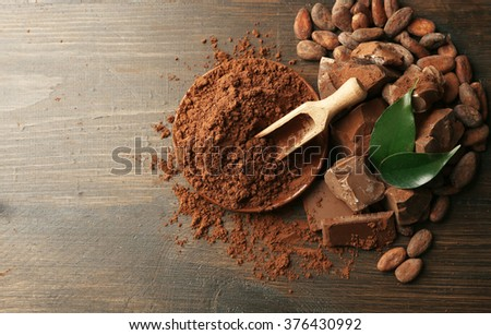 Aromatic cocoa and chocolate on wooden background - stock photo