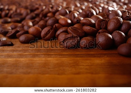 Aromatic Coffee beans on a wooden table - stock photo