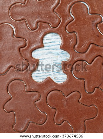 Aromatic dough for Christmas gingerbread man cookies - stock photo