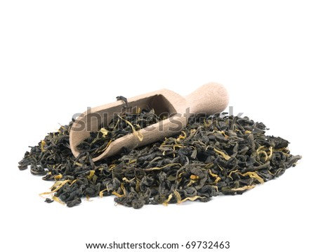 Aromatic green tea leaves with marigold petals and wooden shovel on white background - stock photo