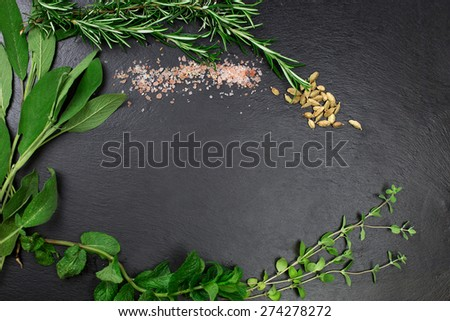 aromatic herbs and dried spices over slate sheet - stock photo