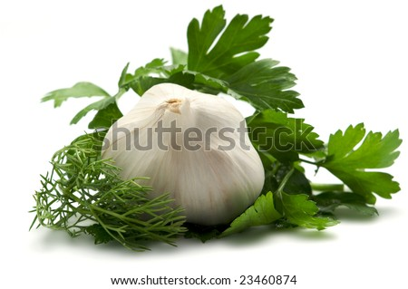Aromatic herbs and garlic are isolated on a white background. Background blurred.