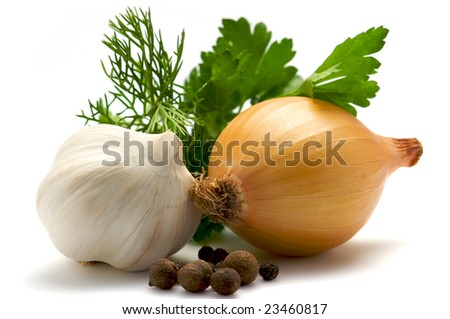 Aromatic herbs, onions and garlic are isolated on a white background. Background blurred. In the foreground is the black pepper.