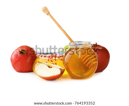 Aromatic honey in jars and fruits on white background