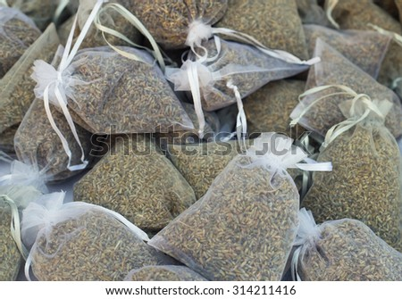 Aromatic pouch with lavandula flowers. Lavender flowers in purple mesh pouches in order to provide an aromatic sachet in Provence. Lavender Gifts in eco friendly packaging. - stock photo