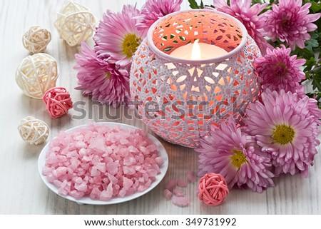 Aromatic sea salt, aroma candle and chrysanthemum flowers/Aromatic sea salt and aroma candle  - stock photo