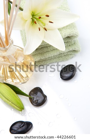 Aromatic spa set - Reed Diffuser and fresh white lily flower. - stock photo
