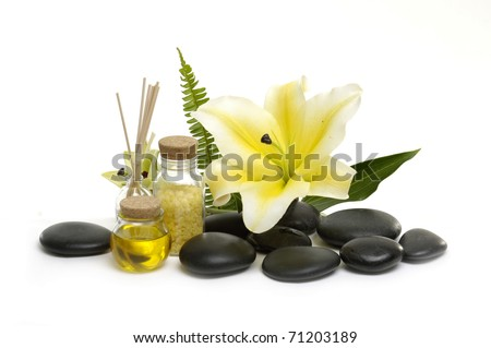 Aromatic spa set - reed diffuser and fresh white lily flower. with green leaf - stock photo