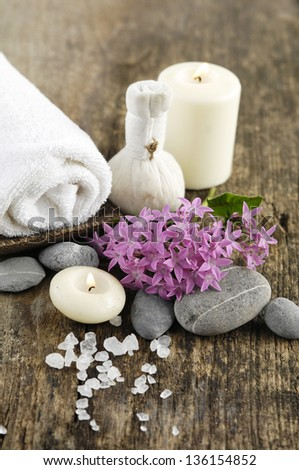 Aromatic spa set with candle , tropical flower,  massage oil and ball with pile of salt,