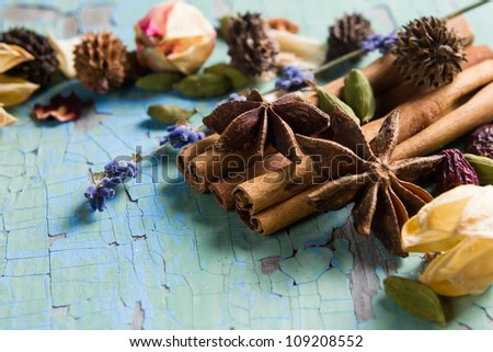 Aromatic spices and herbs on the vintage wooden table - stock photo