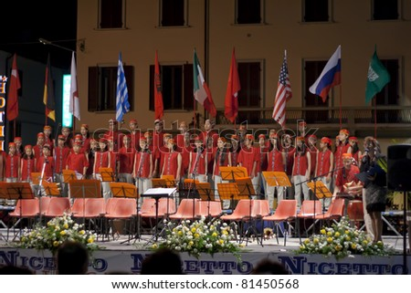 Arona, ITALY - JULY 21: Taipei Philharmonic Youth & Children's Choir performs at  Piazza del Popolo  on July 21, 2011 in  Arona, Italy. - stock photo