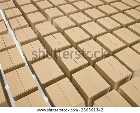 Arranged cardboard boxes on white background - stock photo