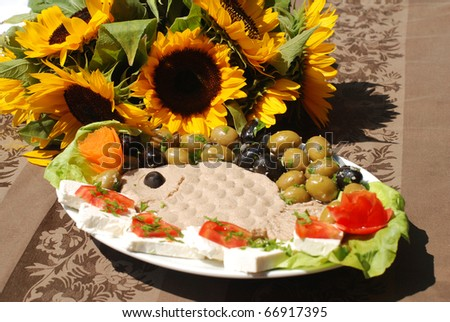 Arranged fish pate with olives and cheese - stock photo