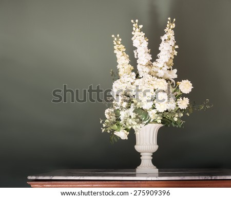 arrangement of artificial flowers on vase in still life vintage art - stock photo
