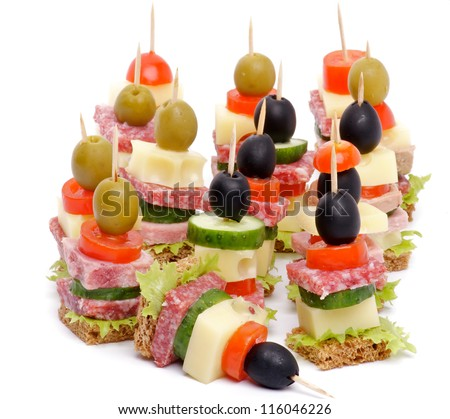 Arrangement appetizers bacon salami tomatoes cheese stock for Gourmet canape ideas