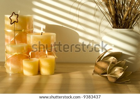 Arrangement of Candles in Sunlight - stock photo