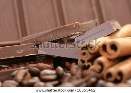 arrangement of chocolate coffee and cinnamon sticks