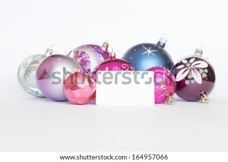 Arrangement of Christmas tree decorations and white card. white background