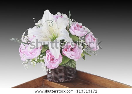 Arrangement of flowers in a vase - stock photo