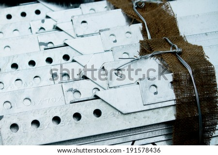 Arrangement of hot-dip galvanized steel angles on the rack in warehouse before shipment