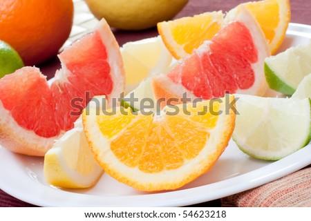arrangement of  lemon, lime, tangerine, orange and grapefruit fruit - stock photo