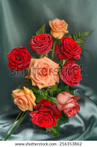 Arrangement of roses on a dark background - stock photo